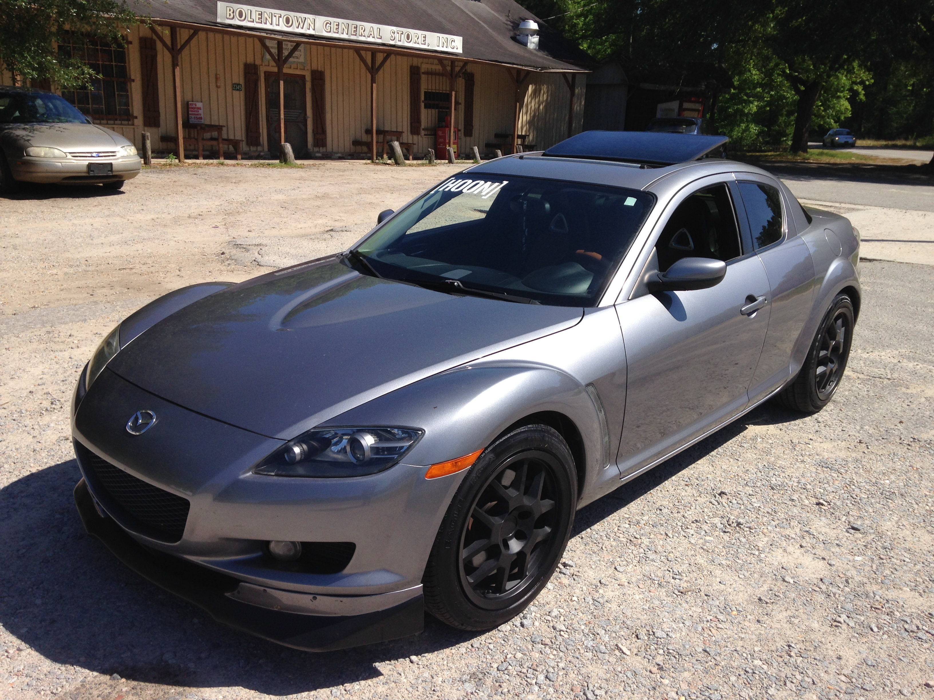 mazda rx8. winning blue and velocity red are nice but that titanium grey ii metallic tho mazda rx8 x