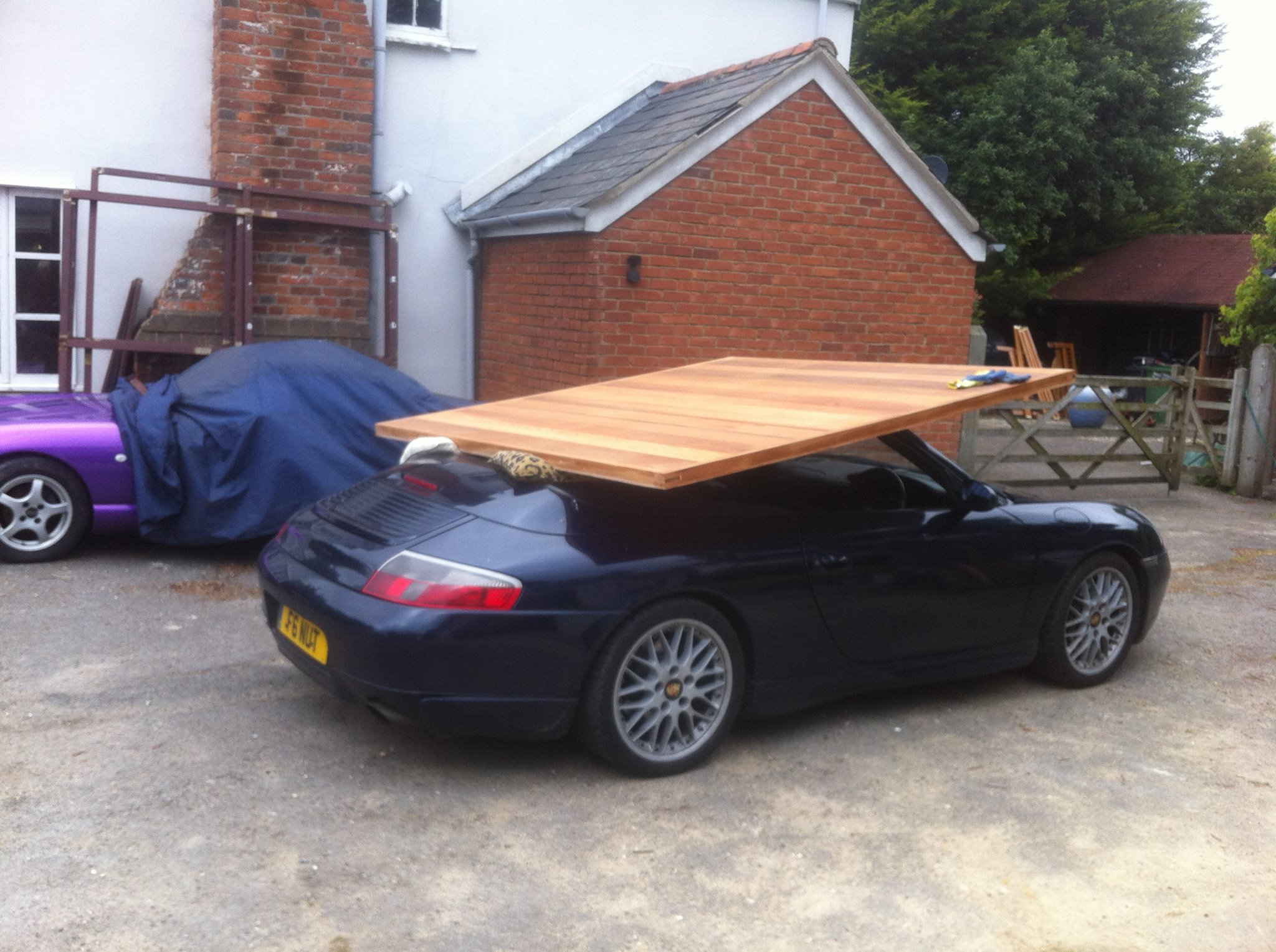 the time we decided to transport a garage door using a 996 911 what stories do you have of hilariously impractical cars being used to transport things