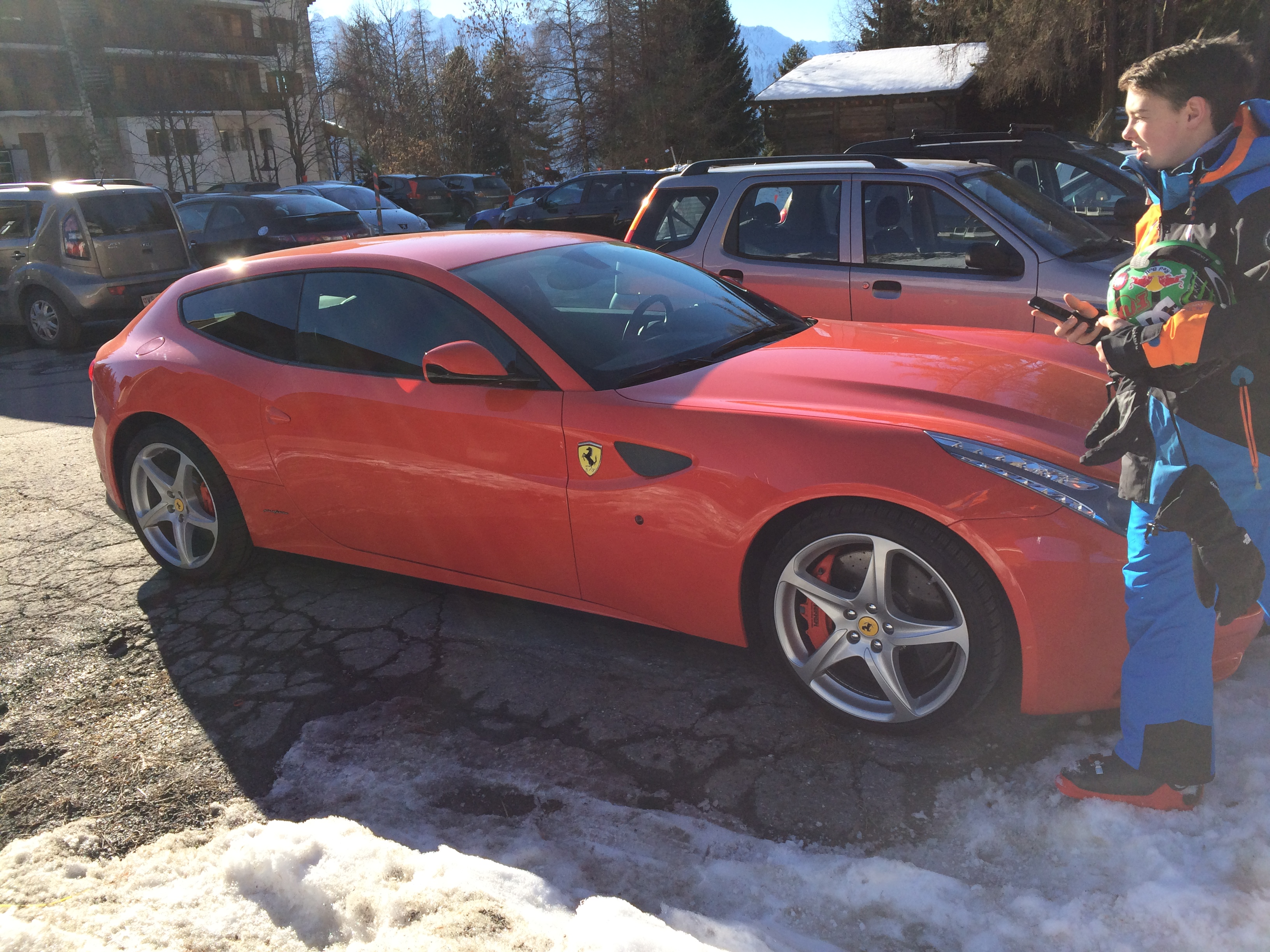 I Found A Ferrari Ff In Switzerland Eating Up The Snow Like It Should Be Nice Speak With A Light Red Exterior And A Black Interior