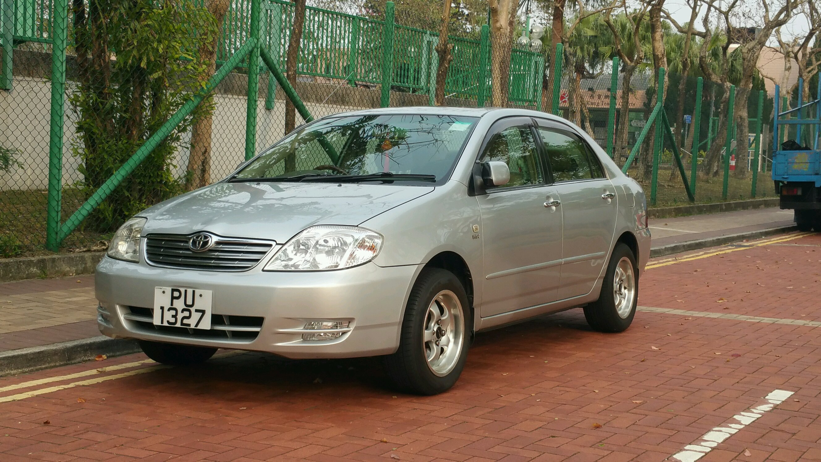 A Standard Toyota Corolla Sedan That Has Been Lifted And Put On