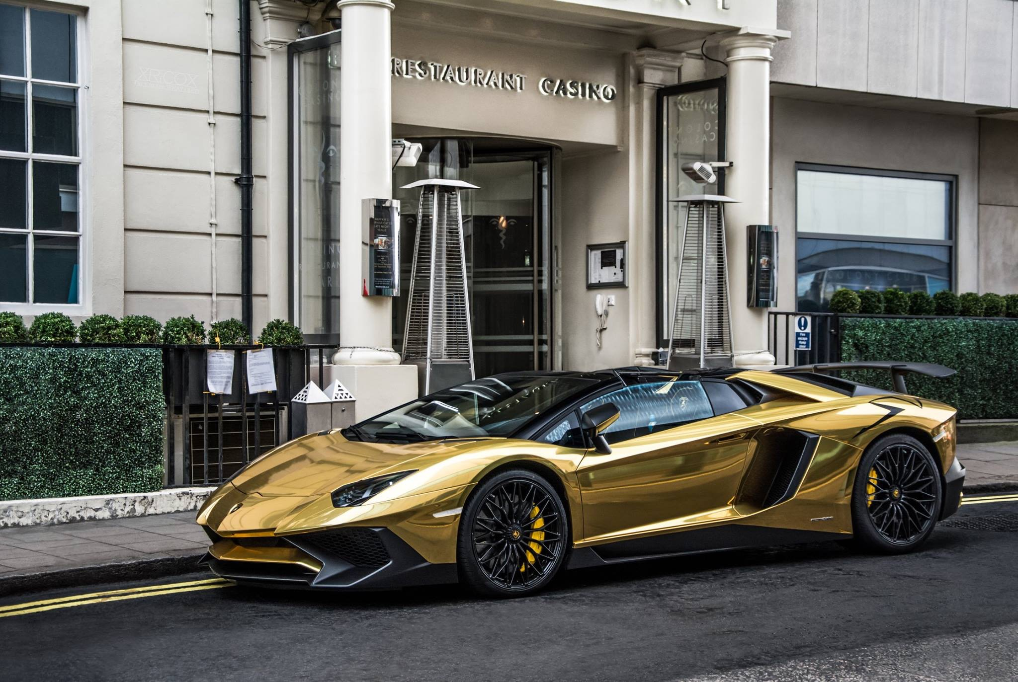 A Gold Lamborghini Aventador Sv Roadster In London