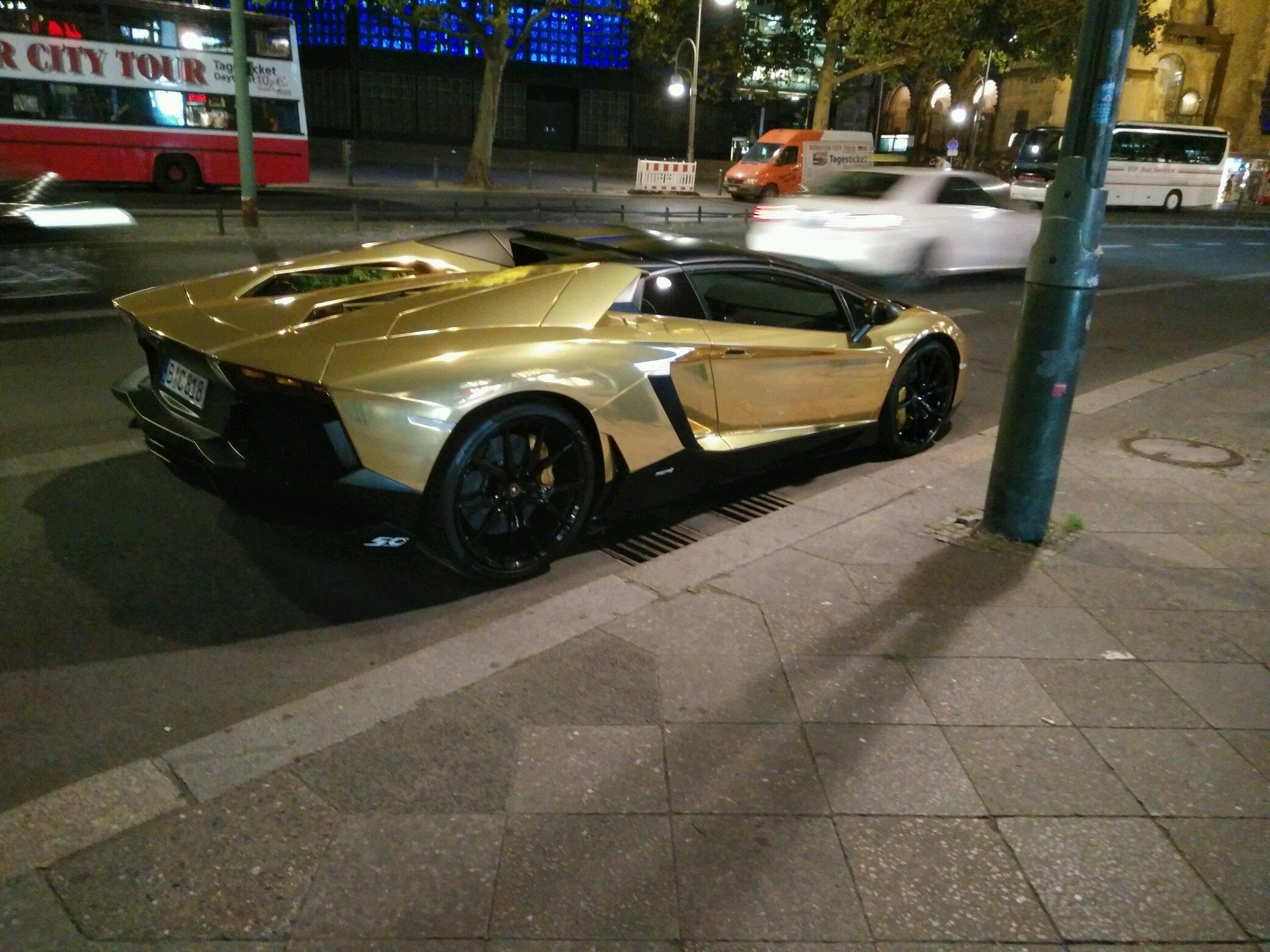 Chrome Gold Aventador Roadster in Berlin on gold ford mustang convertible, gold bmw convertible, gold lamborghini veneno roadster, gold corvette convertible, gold audi convertible, gold ferrari convertible,