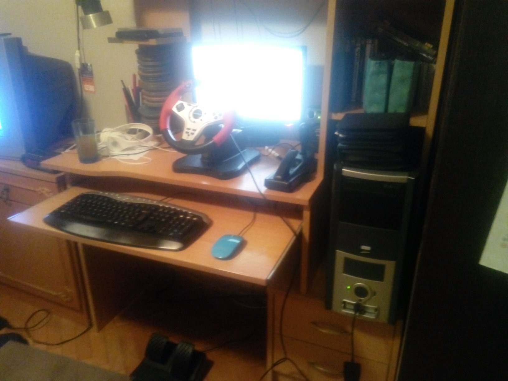 my gaming setup cheap steering wheel and a sleeper pc. Black Bedroom Furniture Sets. Home Design Ideas