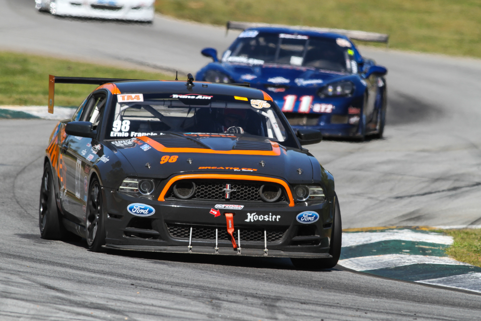 Mustang Trans-Am race car with a Corvette photobombing. Also, is ...